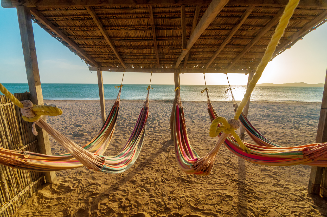 Bright colorful hammocks on the beach at sun